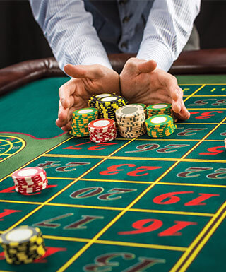 Roulette player bidding all in at table