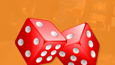 close up of pair of red dice on orange background