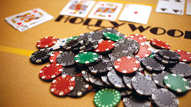 pile of poker chips on a gold poker table
