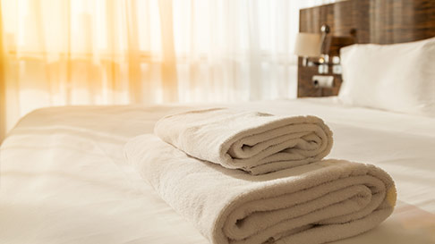 white towels on hotel bed