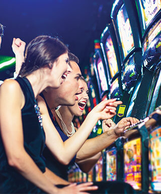 Friends cheering at the slots together