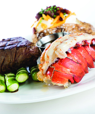 white plate with steak ande lobster tail