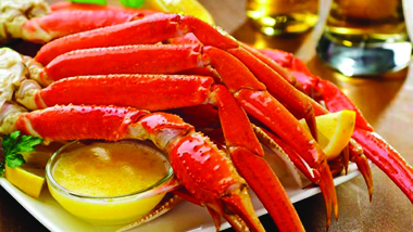 plate of crab legs and dish of melted butter