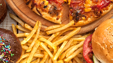 collage of food with pizza, fries and hamburger